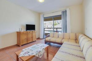 A seating area at Apartamento AguaMarina Beauty