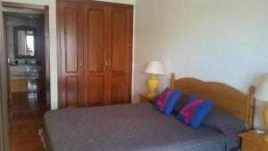A bed or beds in a room at Apartamento AguaMarina Beauty