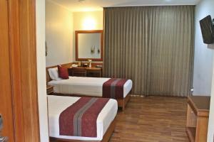 Cama o camas de una habitación en Manohara Resort
