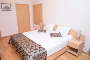 Cama ou camas em um quarto em City Walls Hotel