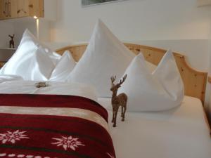 Ein Bett oder Betten in einem Zimmer der Unterkunft Appartements Haus Olympia