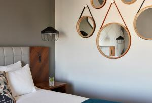 A bed or beds in a room at Hotel Indigo Birmingham
