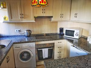A kitchen or kitchenette at Sunny Nerja Apartments