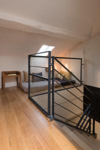 Un ou plusieurs lits superposés dans un hébergement de l'établissement MiHotel Gailleton