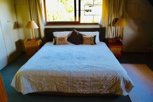 A bed or beds in a room at Manwood Lodge