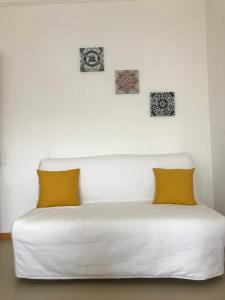 A bed or beds in a room at Casa Green Hill