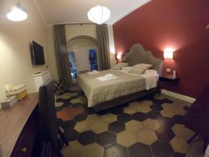A bed or beds in a room at Residenza Roma Imperiale