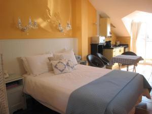 Säng eller sängar i ett rum på Boutique Hotel Pueblo