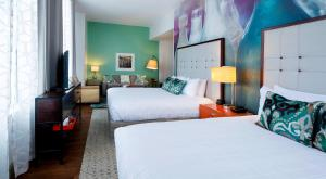 A bed or beds in a room at Hotel Indigo Savannah Historic District, an IHG Hotel