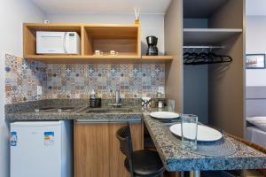 A kitchen or kitchenette at Suíte Completa- Próximo ao aeroporto de Brasília e ParkShopping