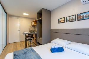 A bed or beds in a room at Suíte Completa- Próximo ao aeroporto de Brasília e ParkShopping