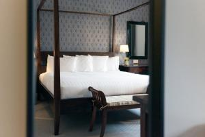 A bed or beds in a room at Asperion Hillside Hotel