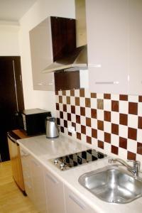 Кухня или мини-кухня в Апарт-отель Мечта