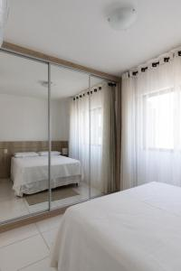 A bed or beds in a room at Portal dos Mares