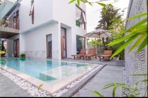 The swimming pool at or close to Green World Hoi An Villa