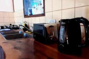 Una cocina o kitchenette en Eolia - Cabaña para 2 personas, excelente ubicación