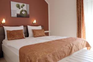 A bed or beds in a room at Apartments Grand Pinea