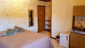 A bed or beds in a room at Residencial Borges