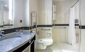 A bathroom at Hampton by Hilton Gdansk Airport