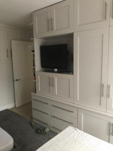 A television and/or entertainment center at Just Hotel !pet friendly!