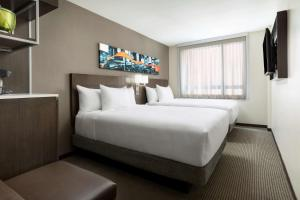 A bed or beds in a room at Hyatt Place New York City/Times Square