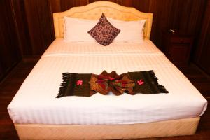 A bed or beds in a room at Palm House Boutique Resort