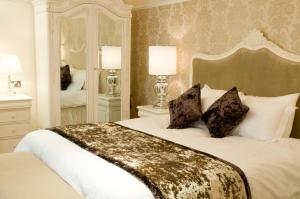 A bed or beds in a room at Alderley Edge Hotel