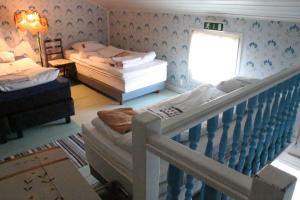 A bed or beds in a room at Hotelli Krepelin