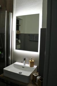 Ein Badezimmer in der Unterkunft Hotel Schmerkötter