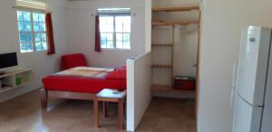 A bed or beds in a room at Mango Garden Cottages