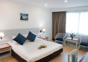 Кровать или кровати в номере Ambassador City Jomtien Marina Tower Wing