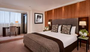 A bed or beds in a room at The Cavendish London