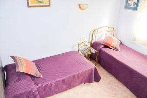 A bed or beds in a room at Villa Sea View Swimming Pool