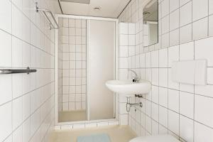 Een badkamer bij Hotel de Waalehof
