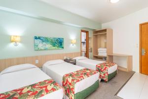 A bed or beds in a room at Eko Residence Hotel - a 200m dos Hospitais da Santa Casa