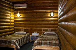Кровать или кровати в номере Поместье Холодный Ручей