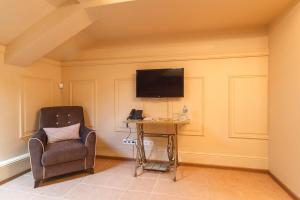 A television and/or entertainment center at Greenwichotel