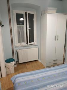Postelja oz. postelje v sobi nastanitve Apartman Luna