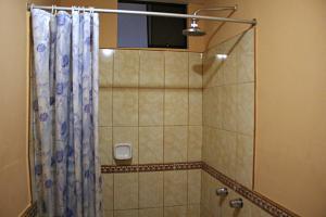 A bathroom at Yuraq Hotel