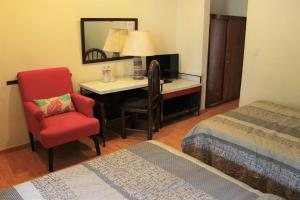 A bed or beds in a room at Hotel Embajadoras