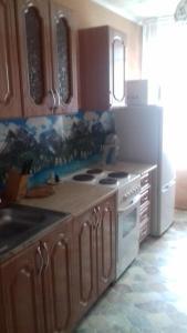 A kitchen or kitchenette at Двухкомнатная квартира посуточно