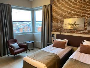 Кровать или кровати в номере Skyline Airport Hotel