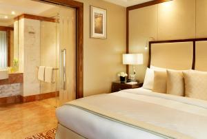 A bed or beds in a room at InterContinental Moscow Tverskaya