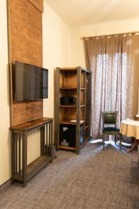 A television and/or entertainment centre at Apricot Hotel Yerevan