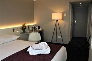 Ein Bett oder Betten in einem Zimmer der Unterkunft Mercure Biel