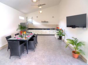 A kitchen or kitchenette at KyGunAya Villa