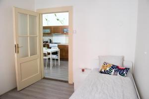 Кровать или кровати в номере Stupkova 2 Apartmán