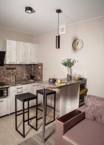 A kitchen or kitchenette at Новая квартира-студия