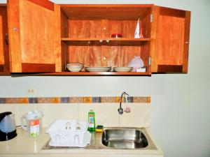 A kitchen or kitchenette at Mini Departamento Iquitos 1243