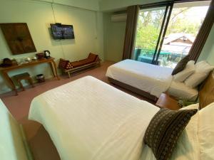 Кровать или кровати в номере A Hotel Budget